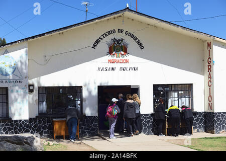 KASANI, BOLIVIA - OCTOBER 10, 2014: Unidentified people standing in line in front of the migration office on the Bolivian side of the border in Kasani - Stock Photo