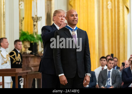 Washington, United States Of America. 16th Sep, 2019. President Donald J. Trump presents the Presidential Medal of Freedom to Mariano Rivera Monday, Sept. 16, 2019, in the East Room of the White House. People: President Donald Trump, Mariano Rivera Credit: Storms Media Group/Alamy Live News - Stock Photo