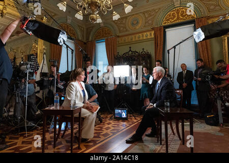 Washington, United States Of America. 18th Sep, 2019. Vice President Mike Pence participates in an interview with Maria Bartiromo of Fox News Wednesday, Sept. 18, 2019, in the Vice PresidentÕs Ceremonial Office in the Eisenhower Executive Office Building of the White House. People: Vice President Mike Pence Credit: Storms Media Group/Alamy Live News - Stock Photo