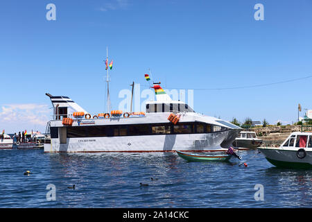 COPACABANA, BOLIVIA - OCTOBER 28, 2014: Big passenger ferry in the harbor of the small tourist town on the shore of Lake Titicaca on October 28, 2014 - Stock Photo