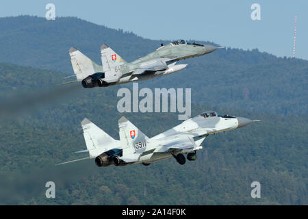 A pair of Slovak Air Force MiG-29AS scrambling for quick reaction alert mission. - Stock Photo