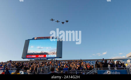 Two F-15E Strike Eagles from the 366th Fighter Wing, Mountain Home Air Force Base, and two A-10 Thunderbolt IIs from the 124th Fighter Wing, Idaho Air National Guard, fly over Albertsons Stadium during the opening ceremony of the Boise State vs. Air Force Game, Boise, Idaho, Sept. 20, 2019. The No. 20 Boise State beat Air Force 30-19. (U.S. Air National Guard photo by Ryan White) - Stock Photo