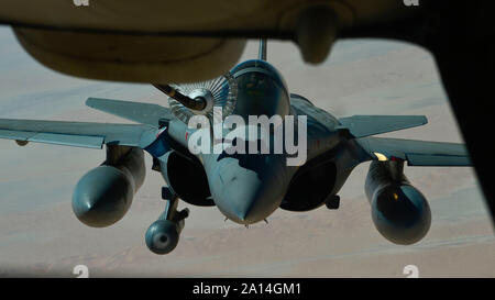 A French Air Force Dassault Rafale receives fuel from a U.S. Air Force KC-10 Extender assigned to the 908th Expeditionary Air Refueling Squadron out of Al Dhafra Air Base, United Arab Emirates, Aug. 28, 2019. Assets under U.S. Air Forces Central Command maintain a constant partnership with regional air forces to augment and perfect capabilities while striving for operational harmony. (U.S. Air Force photo by Staff Sgt. Chris Drzazgowski) - Stock Photo