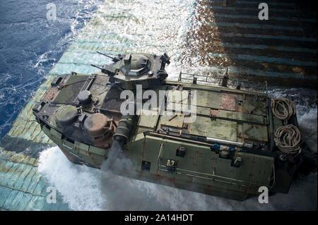 An amphibious assault vehicle departs the well deck of USS Germantown. - Stock Photo