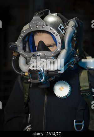 A prototype for a new life support system for divers is displayed on a mannequin. - Stock Photo