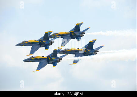 The Blue Angels perform the Diamond 360 maneuver. - Stock Photo