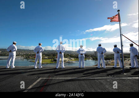 U.S. Sailors and Marines man the rails aboard USS Theodore Roosevelt. - Stock Photo