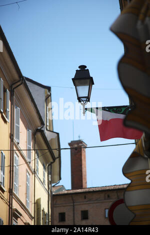 Stylized antique street lamp against the blue sky on the street of the Italian city - Stock Photo