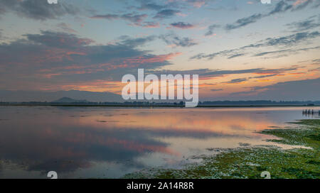 Dal lake in Srinagar at sunset - Stock Photo