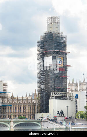 Elizabeth Tower and Big Ben covered in scaffolding for the four years of scheduled repair. Westminster palace partially seen. London, England, UK. - Stock Photo
