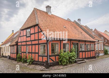 An idyllic half-timbered house in the corner of two cobblestone-streets on the beautiful island Aero, Denmark, July 13, 2019 - Stock Photo