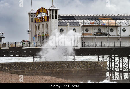 Brighton, UK. 24th Sep, 2019. Waves crash in on the beach by Brighton Palace Pier as wind and rain batters most of Britain today. Credit: Simon Dack/Alamy Live News - Stock Photo
