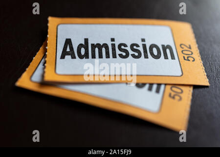 Macro close up of traditional style cinema, theatre or event admission or entrance tickets - Stock Photo