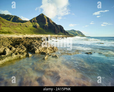 Scenic view of beach in Ka'ena Point State Park against sky - Stock Photo