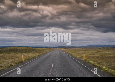 Empty country road in Iceland - Stock Photo