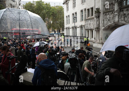 London, UK. 24th Sep, 2019. International media gather outside the Supreme Court after a ruling that the Government's decision to prorogue parliament was found unlawful in London on Friday, September 24, 2019. Britain's top court ruled Prime Minister Boris Jonson acted unlawfully and that Parliament must reconvene immediately. Photo by Hugo Philpott/UPI Credit: UPI/Alamy Live News - Stock Photo