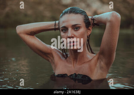 Portrait of young blond woman bathing in a lake Stock Photo