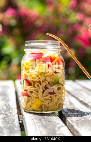 Jar of pasta salad with mango, avocado and cherry tomatoes - Stock Photo