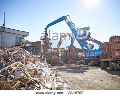 Austria, Tyrol, Brixlegg, Scrap metal being recycled in junkyard - Stock Photo