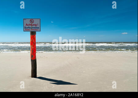 Germany, Schleswig-Holstein, Sankt Peter-Ording, warning sign on the beach - Stock Photo