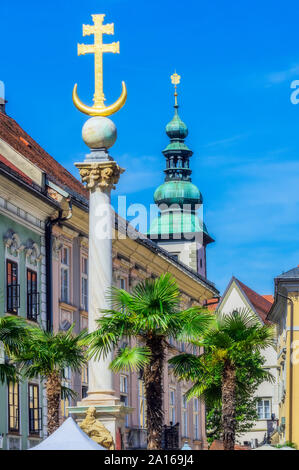 Austria, Carinthia, Klagenfurt am Worthersee, Trinity Column on Alter Platz - Stock Photo
