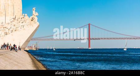 Portugal, Lisbon, Belem, Monument of the Discoveries and 25 de Abril Bridge on Tagus river - Stock Photo