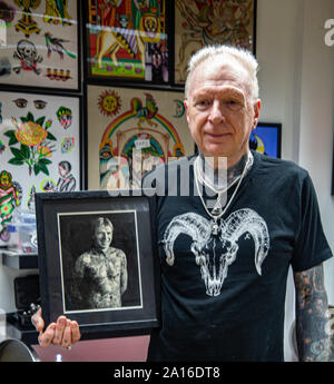 London, UK. 24th Sep, 2019. George Bone holding a photo of himself, the first year he become Guinness World of Record for been the most tatted man in Britain will be attending this year 15th London Tattoo convention, held at the Tobacco Docks London on the 27-29 September.Paul; Quezada-Neiman/Alamy Live News - Stock Photo