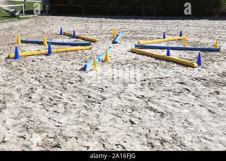 Obstacles for horses in a riding school.Various colorful obstacles for equestrian training - Stock Photo