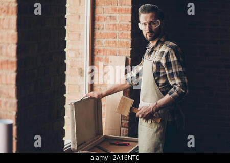 Close up photo portrait of handsome smart guy in protective eyew - Stock Photo