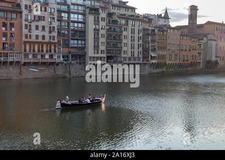 Boaters on Arno River between Ponte Santa Trinita and Ponte Vecchio from Lungarno degli Acciaiuoli at Via Por Santa Maria. Florence, Italy - Stock Photo