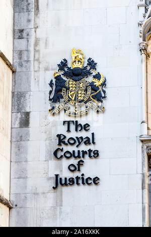 Royal seal and sign at the entrance of the Royal Courts of Justice, Fleet Street, London, UK - Stock Photo