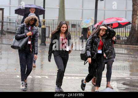 London, UK. 24th Sep, 2019. Women ran for cover during heavy downpour in London. According to the Met Office, remnants of Hurricane Humberto is forecast to batter the UK with heavy downpour for the next few days. Credit: Steve Taylor/SOPA Images/ZUMA Wire/Alamy Live News - Stock Photo