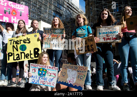 School students strike to create awareness of the climate catastrophe. A group of girls with placards in Whitehall