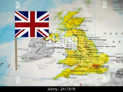 Map of United Kingdom with Union Jack at front - Stock Photo