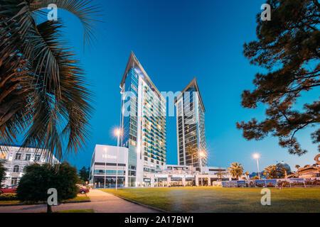 Batumi, Adjara, Georgia - September 10, 2017: Building Of Hilton Hotel In Evening Or Night Illuminations. Urban Architecture Of Georgian Resort Town O - Stock Photo