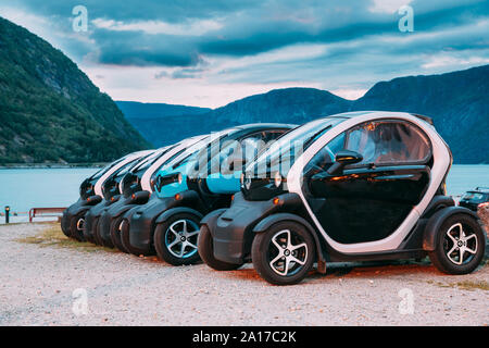 Eidfjord, Norway  - June 13, 2019: Many Black And Blue Colors Renault Z.E. Cars Parked In row. The Renault Z.E. or Zero Emission is a line of all-elec - Stock Photo