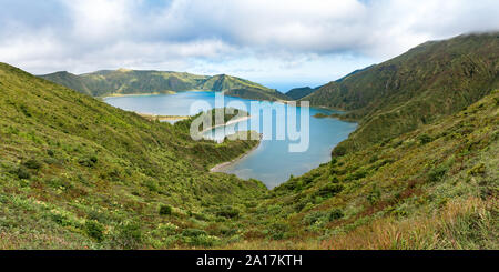 Panoramic view of Lagoa do Fogo, a crater lake on the island of São Miguel in the Azores archipelago.  The blue lagoon is in the central caldera. - Stock Photo