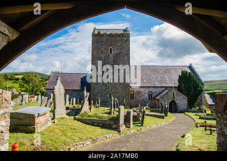 St Cenydd's Church, Llangennith , a 12th century church on the site of a 6th century llan, or churchyard, which retains the original circular footprint. Llangennith, Gower Wales UK - Stock Photo