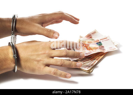 Hands grab Russian money isolated on a white background. Concept of currency theft or fraud - Stock Photo