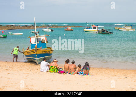 Praia do Forte, Brazil - Circa September 2019: People enjoying a sunny Sunday at Praia do Forte - popular beach near Salvador, Bahia - Stock Photo
