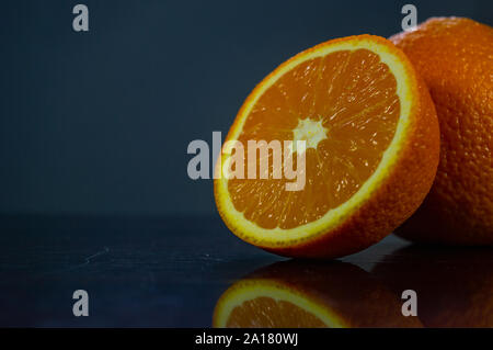 Ripe organic oranges on a table. Fruits. Fruit concept. - Stock Photo