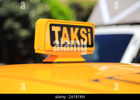 Yellow taxi car roof sign close-up. Taksi car sing in Turkey - Stock Photo