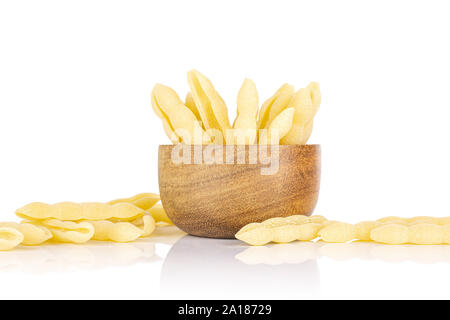 Lot of whole uncooked pasta cavatelli in wooden bowl isolated on white background - Stock Photo