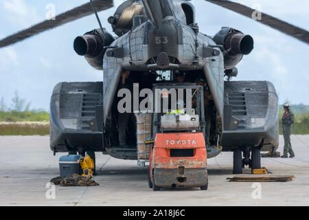 190911-F-XP529-065    NASSAU, Bahamas – U.S. Navy Sailors load supplies and equipment onto a MH-53E Sea Dragon in Nassau, Bahamas, Sept. 11, 2019.  U.S. Northern Command provided military-unique capabilities to the U.S. Agency for International Development, enabling the broader relief efforts addressing the acute humanitarian needs of the Bahamian people.   (U.S. Air Force photo by TSgt. Paul E. Cook) - Stock Photo