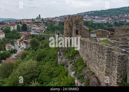 Veliko Tarnovo, Bulgaria - 8 may, 2019: Gate tower and ruins of Tsarevets fortress with a view of the old town of Veliko Tarnovo in the background, Bu - Stock Photo