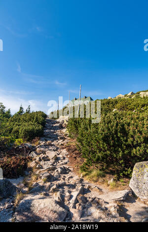 stone hiking trail on Szrenica hill with hut in Karkonosze mountains in Poland - Stock Photo