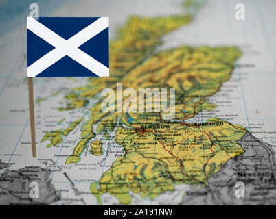 Map of Scotland with national flag at front. - Stock Photo