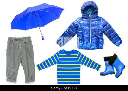 Collage set of children clothes. Denim jeans or pants, rubber boots, a shirt and a rain jacket and umbrella for child boy isolated on a white backgrou - Stock Photo