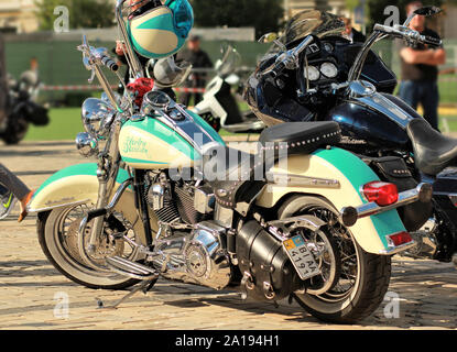 Kyiv, Ukraine - 20 May 2017 - Motorcycle show - Vintage Harley Davidson motorbike with a matching helmet - Stock Photo