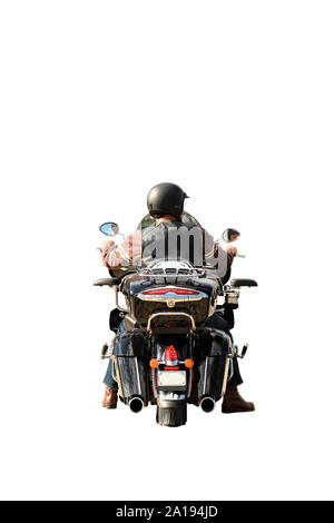 Portrait of a biker riding a wet motorcycle with rain drops, isolated on white background, back view, face reflection in the mirror - Stock Photo